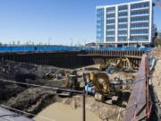 Water from the Columbia River has started to become visible at river level at the bottom of the Hotel Indigo construction site on Block 4 of The Waterfront Vancouver. The water is a normal and expected part of the construction process, officials said.