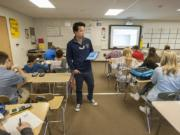 View Ridge Middle School math teacher Nam Nguyen works with eighth-grade students at View Ridge Middle School.