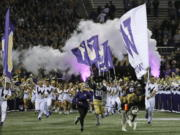 Dubs II, the Washington Huskies live mascot, leads the team out of the tunnel for an NCAA college football game against Arizona State, Saturday, Sept. 22, 2018, in Seattle. (AP Photo/Ted S.