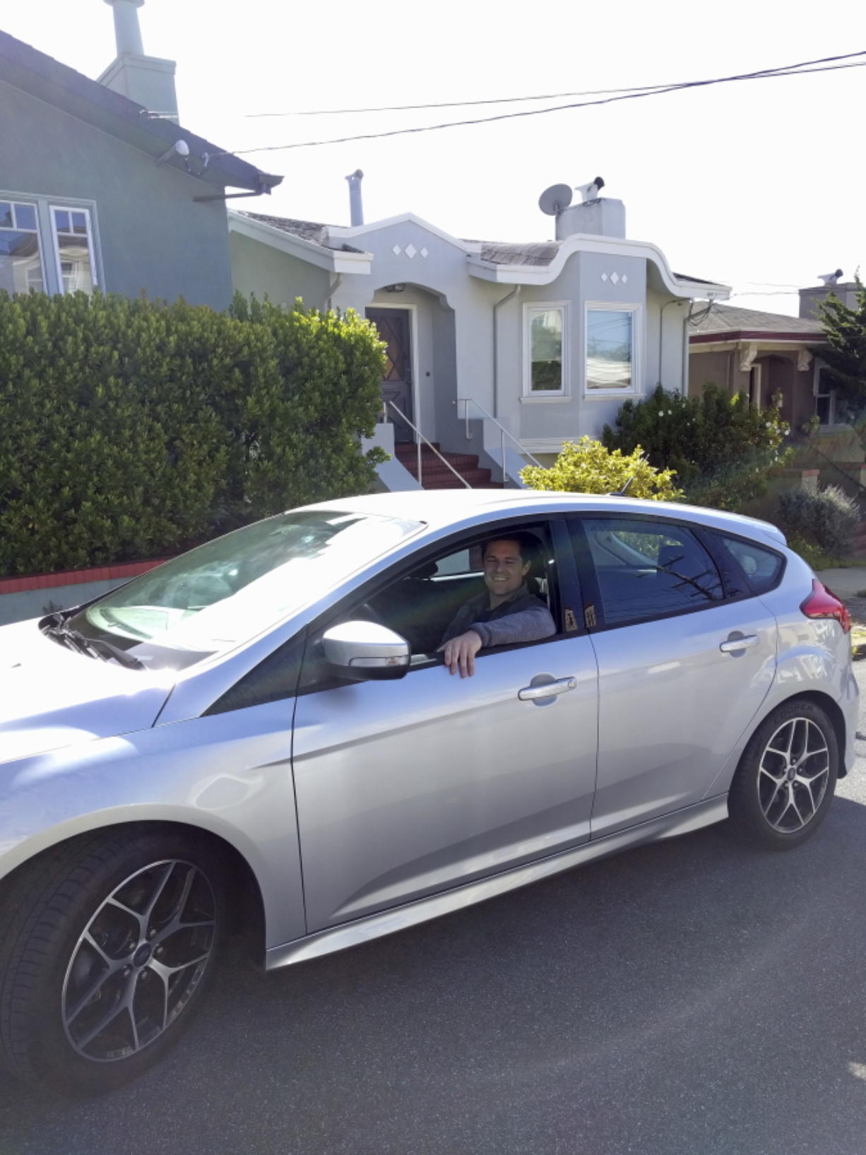 Canvas' first subscriber, James O'Connor, sits in his car from the company, which lets drivers pay to use a car without a long-term commitment.