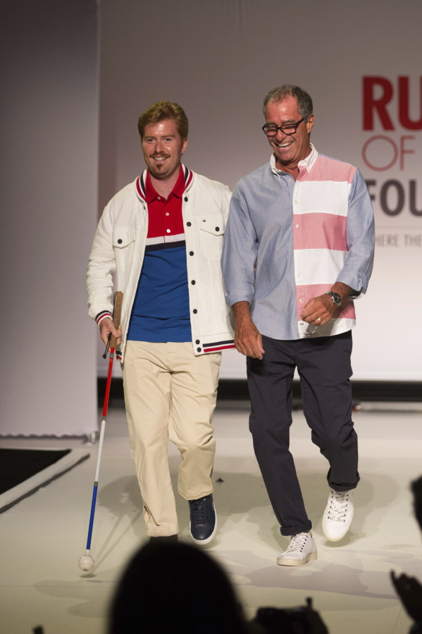 29d266f74 ... wearing adaptive clothing for children and adults. Kevin  Hagen/Associated Press. The Runway of Dreams collection is modeled by  Griffin Pinkow, left, ...