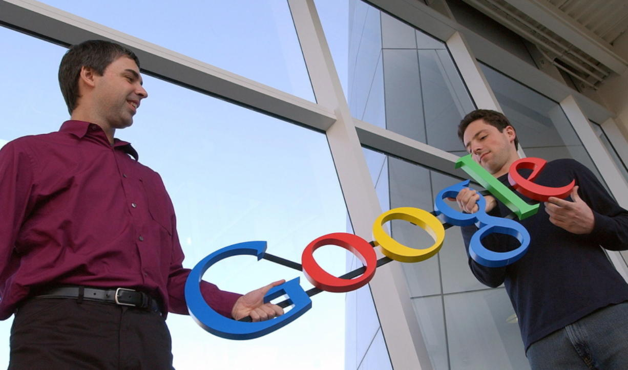 FILE- In this Jan. 15, 2004, file photo Google co-founders Larry Page, left, and Sergey Brin pose for a photo at their company's headquarters in Mountain View, Calif. Twenty years after Page and Brin set out to organize all of the internet's information, the search engine they named Google has morphed into a dominating force in smartphones, online video, email, maps and much more.