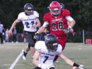 Hockinson's Nick Charles (bottom) works to gather a blocked punts with Archbishop Murphy's Evan Thode (28) trailing Thursday night at Archbishop Murphy High School in Everett on September 6, 2018.
