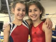Local gymnasts Athena Lee, left, and Hadley Palmerton were selected to compete in Indianapolis this month in the USA Gymnastics Talent Opportunity Program, which seeks to identify youths with the potential to become elite gymnasts.