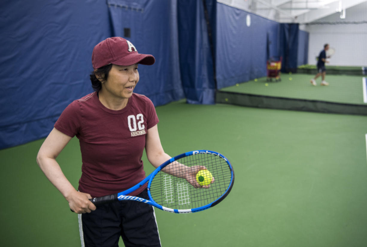 Akemi Noll plays tennis with her husband, Joe, at Vancouver Tennis Center. She was diagnosed with Parkinson's disease 12 years ago and used a wheelchair for a majority of those years. She recently gained more mobility after a deep brain stimulation surgical treatment. She now plays tennis three times a week and wants to try skiing.