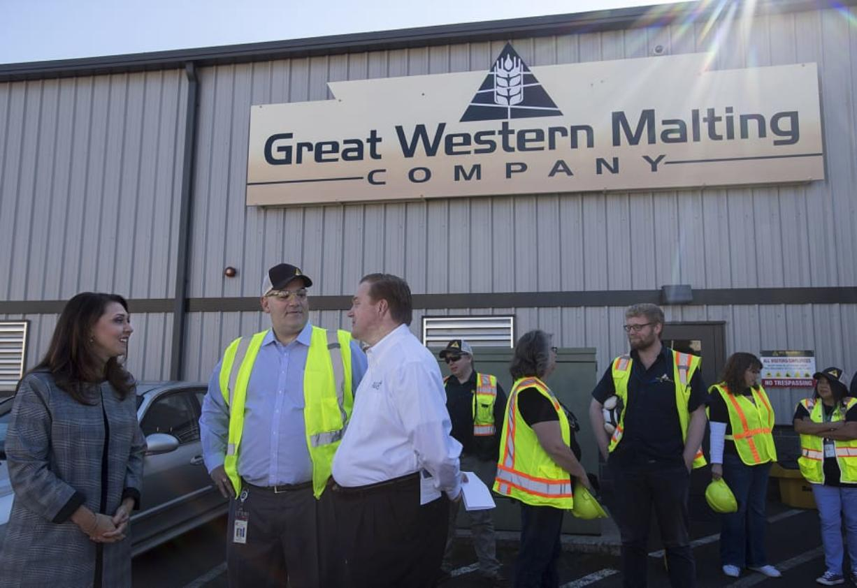 Rep. Jaime Herrera Beutler, from left, chats with Mike O'Toole, president of Great Western Malting, and Kris Johnson, president and CEO of Association of Washington Business, during a visit Friday morning to the Port of Vancouver.
