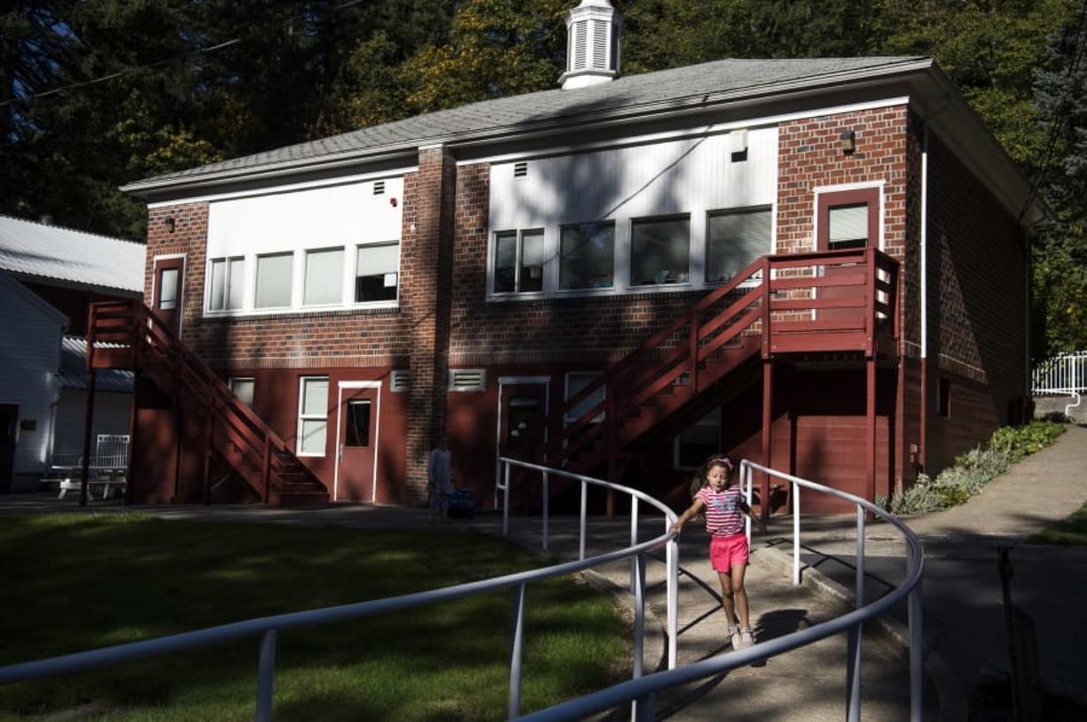 Kindergartner Piper Caseday runs down the ramp for recess at Green Mountain School.