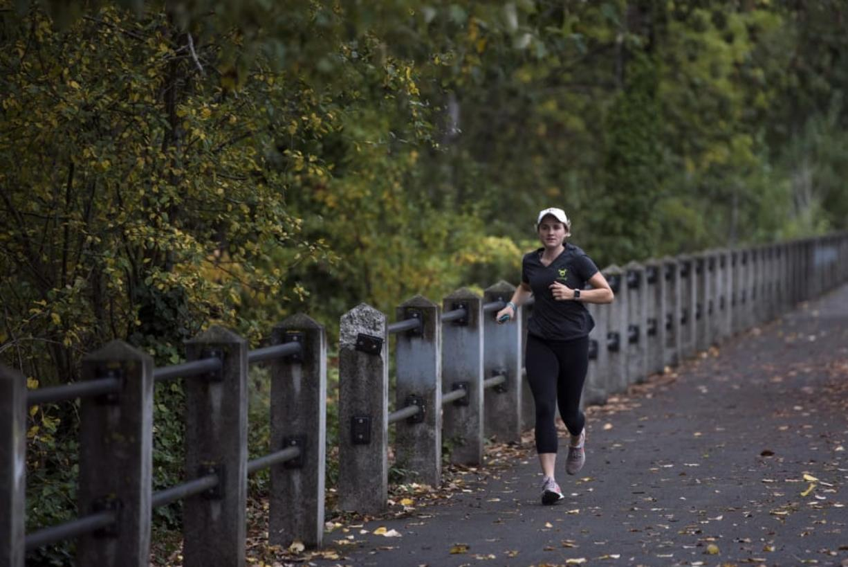 Kirsten Myers of Vancouver runs along the Vancouver Waterfront Renaissance Trail. Myers has joined fellow runners with Type 1 diabetes to run the New York City Marathon next month on the Beyond Type 1 team. The team aims to spread awareness and inspire others with Type 1 diabetes.