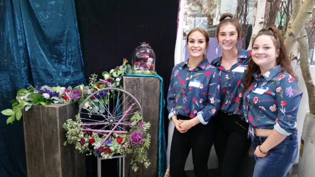 Portland: Evergreen High School students, from left, Autumn Kimble, Shelbeigh Weaver and Brianna Schrantz won first place in the second Frank Adams Annual Floral Chopped Competition.