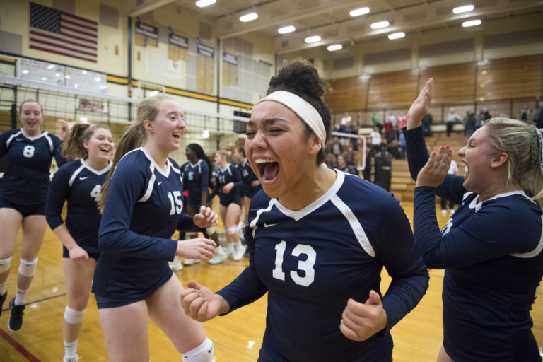 Skyview's Tyra Schaub (center right) celebrates with her team following a victory over Camas at Hudson's Bay High School on Tuesday night, Oct. 30, 2018. (Nathan Howard/The Columbian)