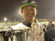 Travis Reeder, a Columbia River High graduate, holds the Formula Drift Pro2 season championship trophy for 2018. He clinched the title last Saturday at Irwindale, Calif.