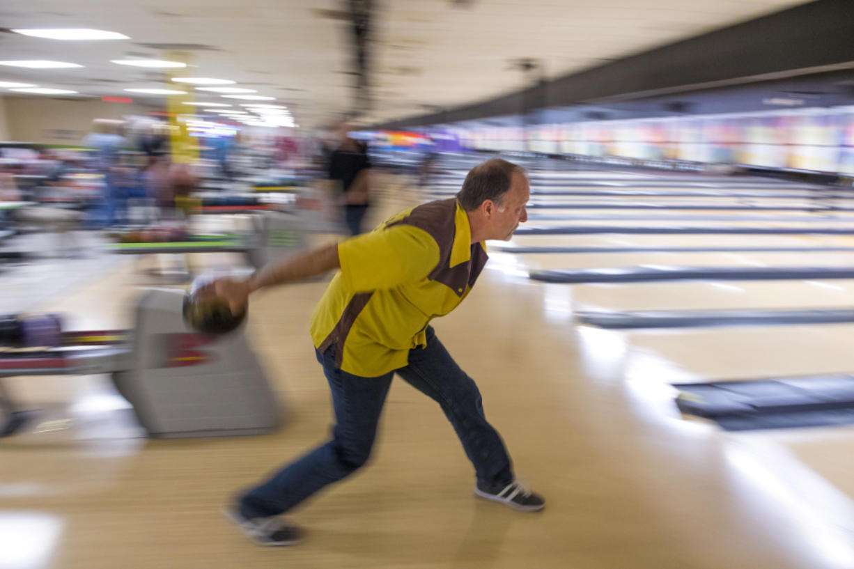 Scott Alexander of Hockinson prepares his throw while bowling in the The Lutheran Mixed Bowling League at Allen's Crosley Lanes on Monday night, Oct. 2, 2018.