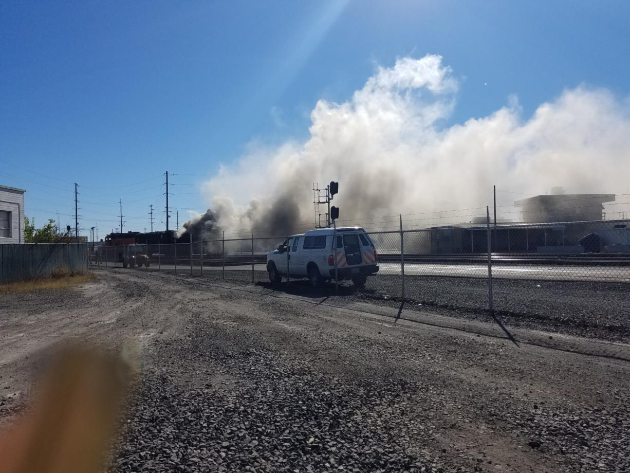 A BNSF rail car burns after catching fire around 12:50 p.m. Sunday. A spokesperson for the company could not immediately be reached for comment.