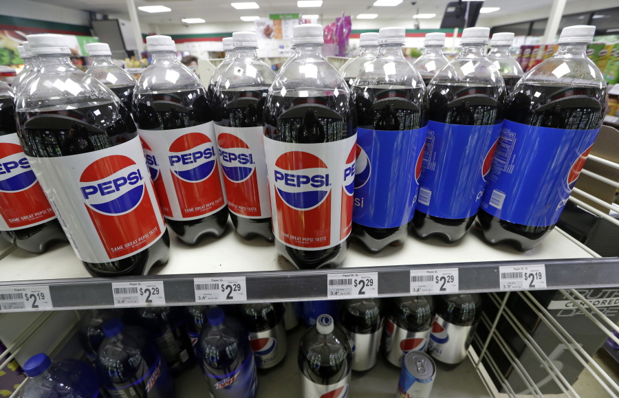 Pepsi products fill shelves in a convenience store in Kent.