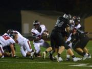 Camas running back Jacques Badolato-Birdsell finds a hole in the Union defense at McKenzie Stadium in Vancouver on Friday, October 26, 2018. Union beat Camas 14-7.