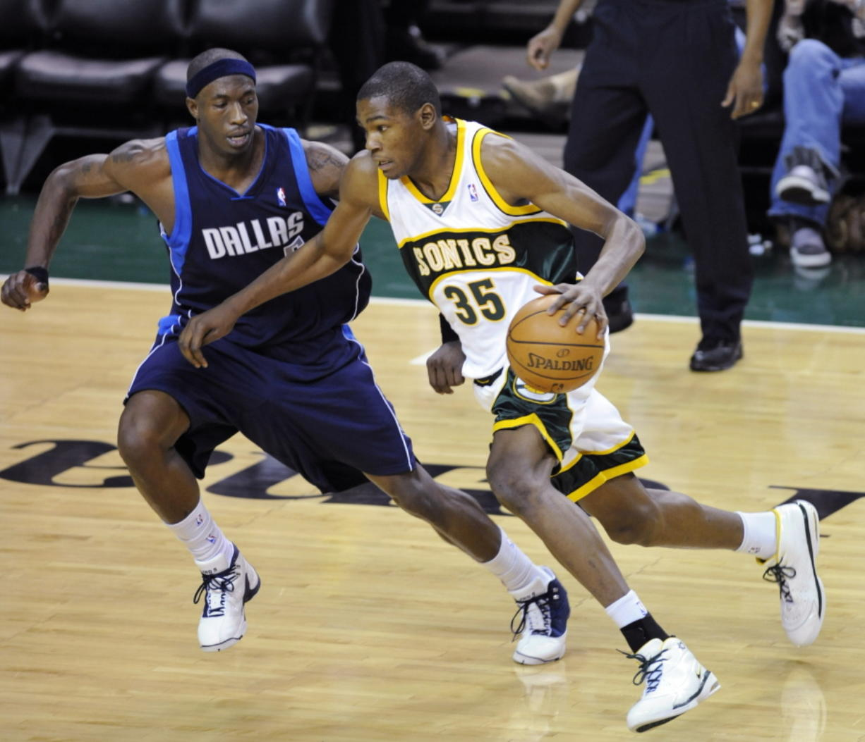 From 2008, Seattle SuperSonics' Kevin Durant (35) tries to drive past Dallas Mavericks' Josh Howard during an NBA game at KeyArena in Seattle. KeyArena is getting an appropriate send off Friday, Oct. 5, 2018, with an NBA game being played once again under its roof as the former home of the SuperSonics will see the Golden State Warriors meet the Sacramento Kings in a preseason game. Afterward, the building will be shuttered and remodeled.