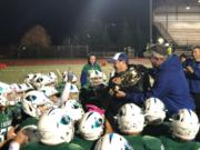 Mountain View coach Adam Mathieson carries the title belt after the Thunder finished first in the 3A Greater St. Helens League on Thursday, Oct. 25, 2018.