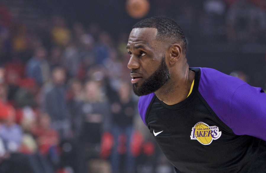957599b81a994 Los Angeles Lakers forward LeBron James partakes in warm ups before an NBA  basketball game against