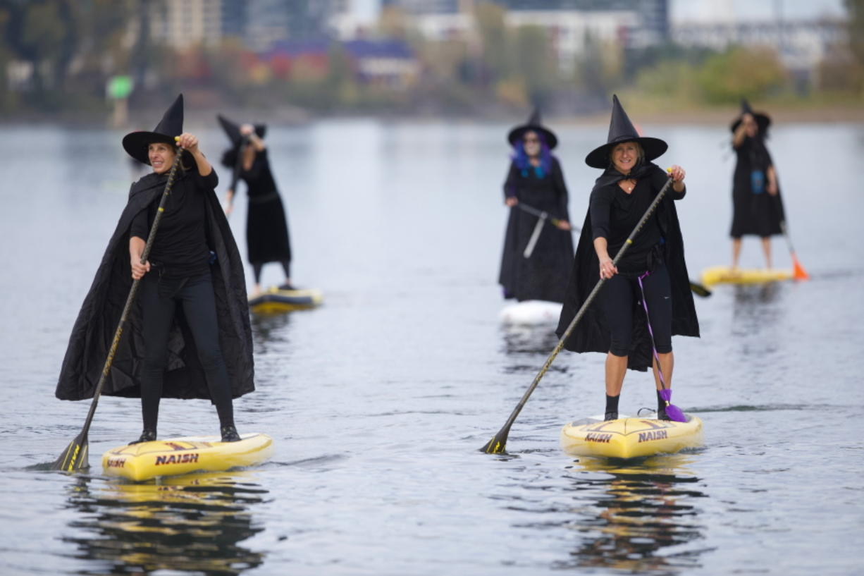 Hundreds of Oregon 'witches' paddle down river, minus the