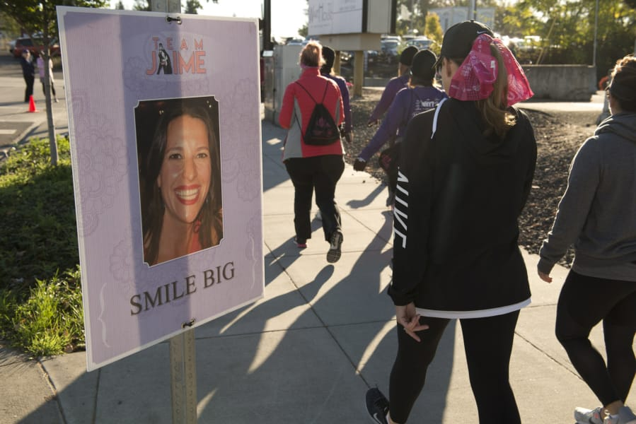 Posters in memoriam of local woman Jamie Miller dot the route of the 12th  annual Girlfriends