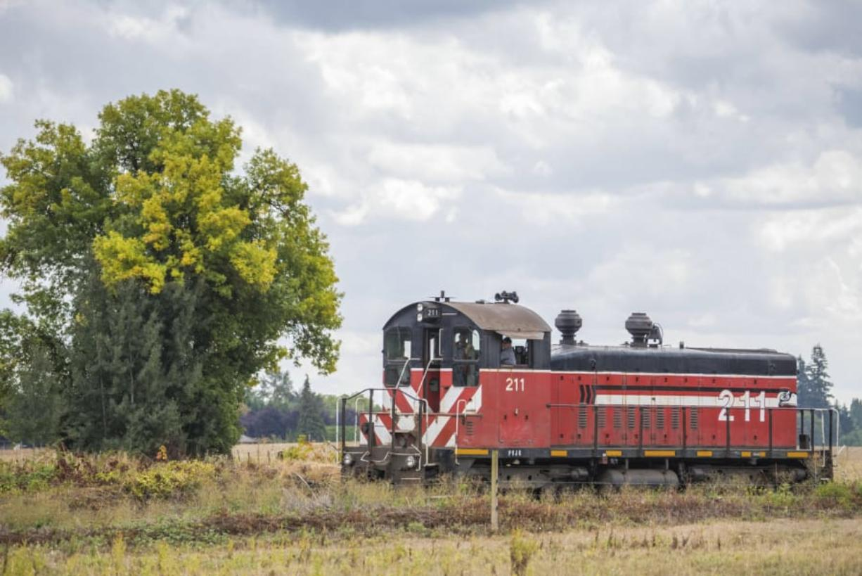 A Portland Vancouver Junction Railroad rail car travels along the Chelatchie Prairie Railroad.