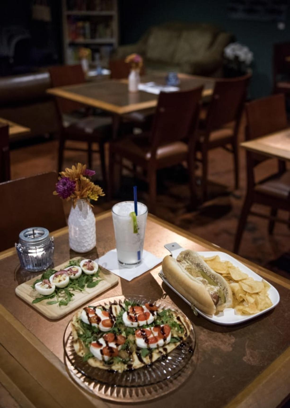 The fancy deviled eggs, from left, clockwise, the Lime in the Coconut cocktail, the Chicago dog, and the UnderBar flatbread.