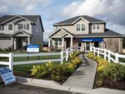 Lennar Homes homes, like this one in the Kennedy Farm subdivision in Ridgefield, come with built-in wireless access points and automated technology such as thermostat, music, lighting, entertainment and security control.