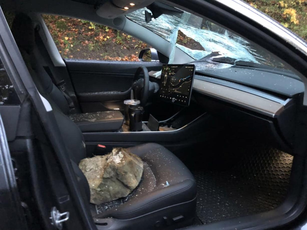 A nearly 40-pound rock fell from a cliff near Cape Horn and smashed through the windshield of Clark County resident Jade Insko's Tesla Model 3 as he was driving along state Highway 14 on Monday morning. Insko walked away with minor cuts.