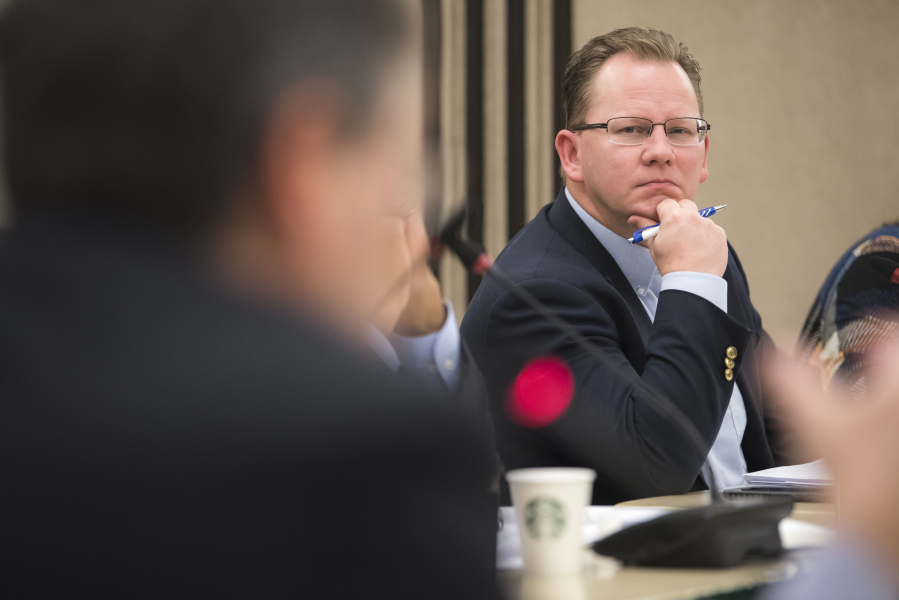 Superintendent of Public Instruction Chris Reykdal listens to a member of the Washington State Board of Education speak in 2018 at Educational Service District 112 in Vancouver. The board is in Vancouver this week for its last meeting of the year.