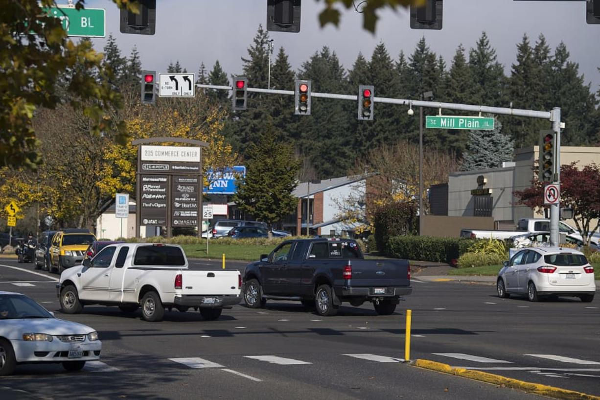 Motorists run through a red light at the intersection of Southeast Mill Plain Boulevard and Chkalov Drive. About a decade ago, the city considered putting a red-light camera at the intersection but never did. Since then, both the city and the county have opted for a different approach to policing red-light scofflaws.