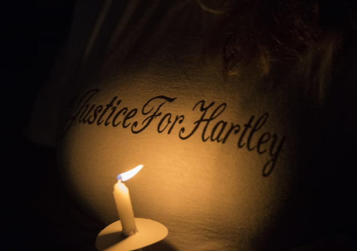 A woman shows her support with her T-shirt during a candlelight vigil in honor of Hartley Anderson, 5, on Friday evening at LeRoy Haagen Memorial Park in Vancouver.
