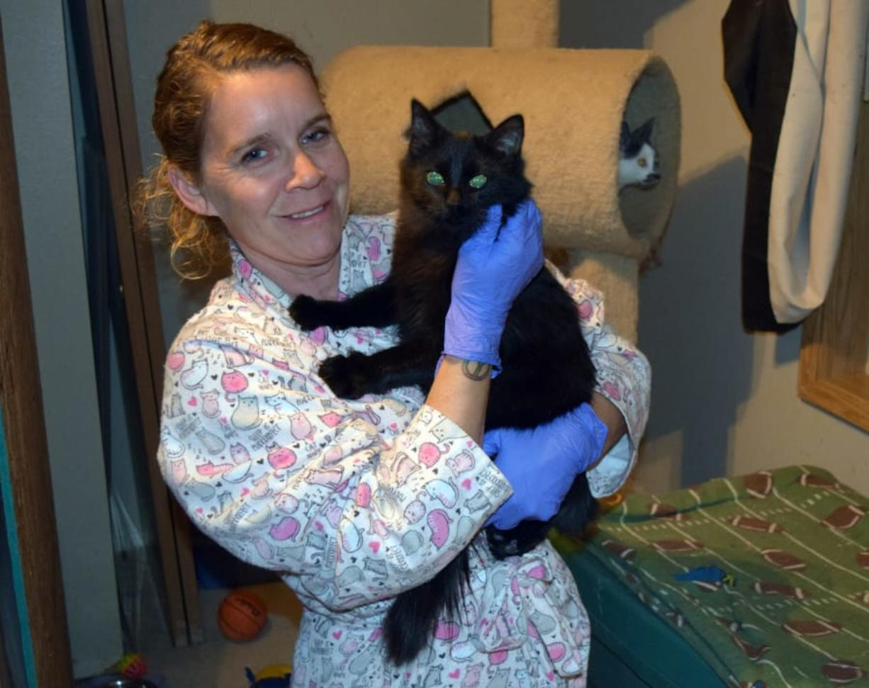 Dena Hugh cuddles Bradley in the kitten room at her house, where she cared for 10 kittens who came to Furry Friends from a hoarding situation in Cowlitz County. Hugh has volunteered with Furry Friends since December 2015.