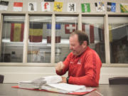 Camas Soccer Coach Roland Minder looks through a notebook containing notes from a past season in his classroom at Camas High School on Tuesday afternoon, Nov. 13, 2018.