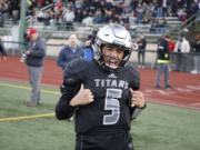 Union quarterback Lincoln Victor scores against Puyallup.