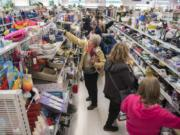 Shoppers pack an aisle of the new Vancouver Goodwill at 14201 N.E. Fourth Plain Blvd. during the grand opening Thursday.