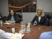 Candidates for state representative from the 17th District, Position 1, Tanisha Harris, left, and Vicki Kraft speak to the editorial board at The Columbian in Vancouver in 2018.