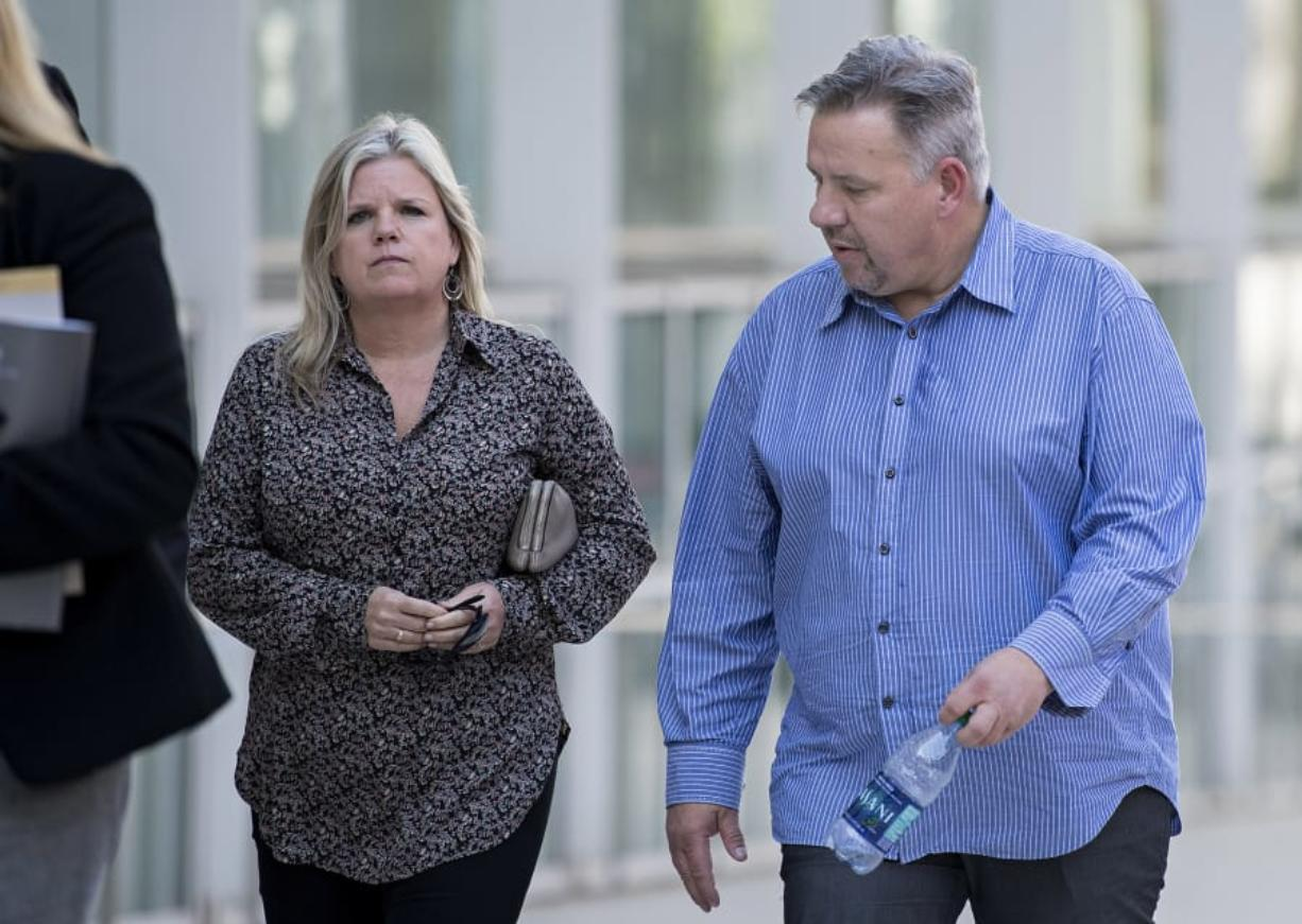 Michelle Bishop, left, estranged wife of former Vancouver pastor John Bishop, right, walk toward James M. Carter and Judith N. Keep United States Courthouse in San Diego, Calif., on Friday afternoon, Sept. 21, 2018.