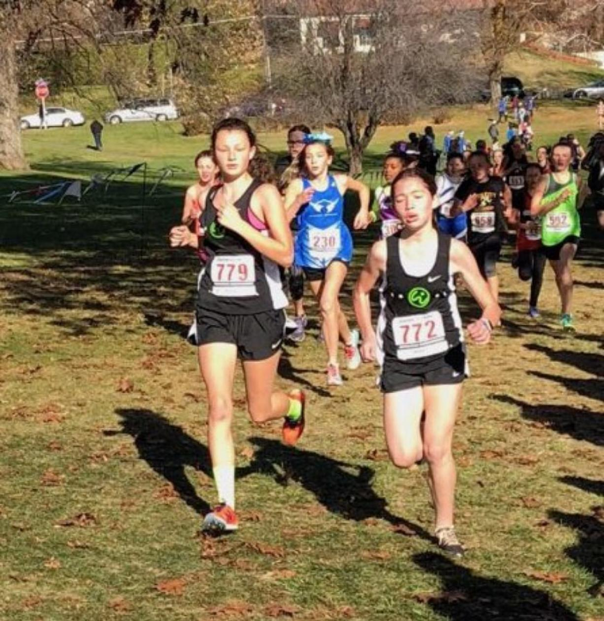 Abigail Rounds, left, and Addison Crum compete in the 11-12 age group race at the USATF Junior Olympic Regional cross country meet Saturday in Yakima. They run for Vancouver-based Whisper Running, which qualified 21 runners for Nationals next month in Reno, Nevada. (Photo courtesy of Dave Caldwell).