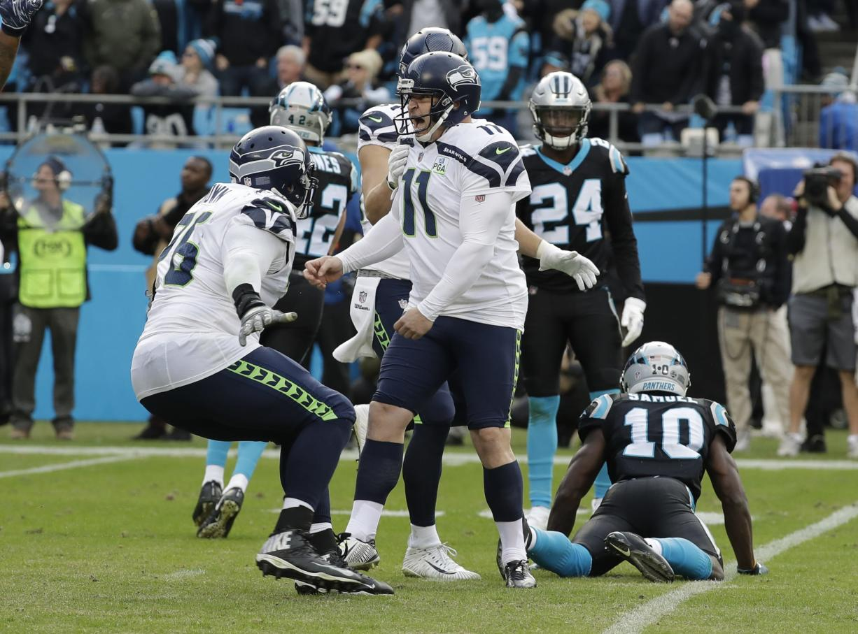 Seattle Seahawks' Sebastian Janikowski (11) celebrates after his game-winning field goal against the Carolina Panthers during the second half of an NFL football game in Charlotte, N.C., Sunday, Nov. 25, 2018.