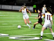 Prairie midfielder Maya Davis dribbles past a defender in the second half of a 3-1 loss to Holy Names in the 3A state semifinals at Puyallup's Sparks Stadium.