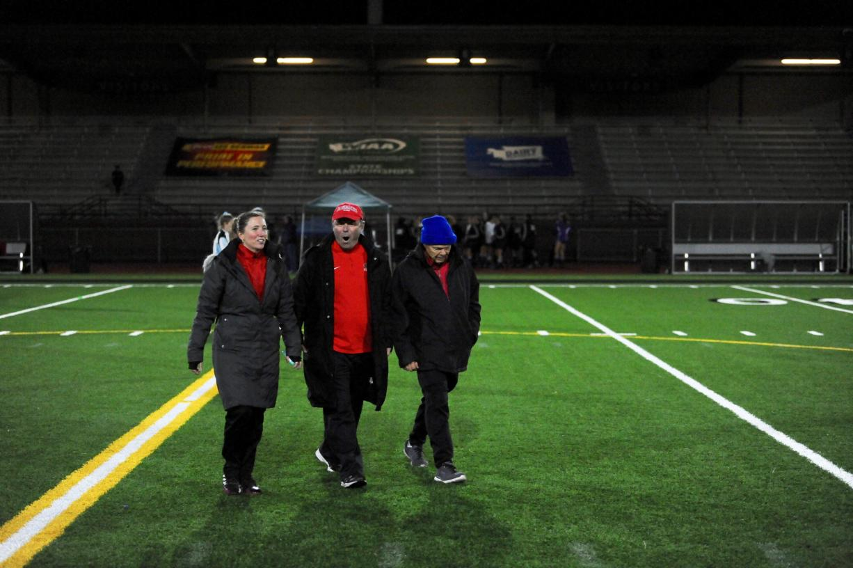 Keri Tomasetti (left) will take over the Camas girls soccer program, replacing Roland Minder (center).
