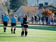 Prairie players embrace in the moments after the final whistle, marking the end of their season after a 3-0 loss at Sparks Stadium in Puyallup on Saturday, Nov. 17, 2018.