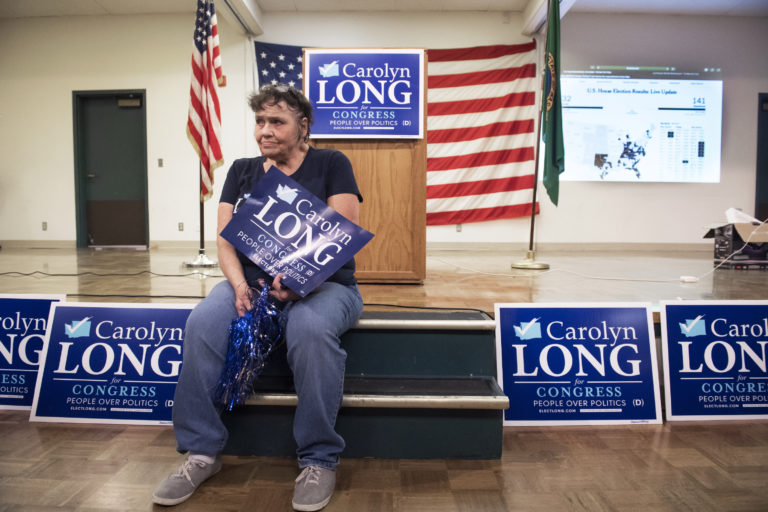 "Kathy Dering of Washougal waits for election results while at an election party for Carolyn Long, Democratic candidate for the 3rd Congressional District, at the Luepke Center on Tuesday night, Nov. 6, 2018. ""I know she's going to win, I checked my tea leaves... If she loses I guess I'll have to get new tea leaves,"" Dering said of Carolyn Long. (Nathan Howard/The Columbian)"