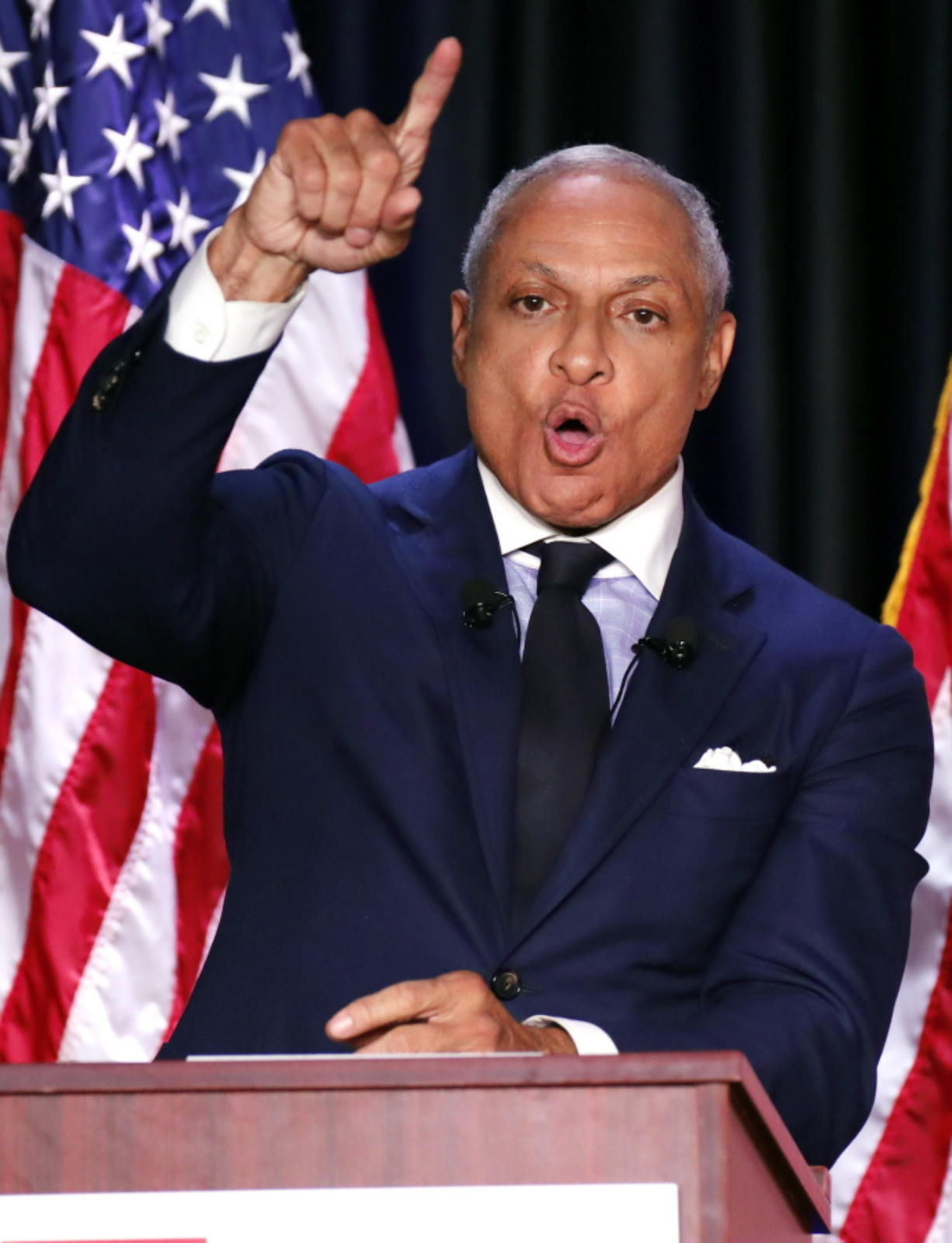 Democrat Mike Espy responds to a statement from his opponent, appointed U.S. Sen. Cindy Hyde-Smith, R-Miss., during a televised Mississippi U.S. Senate debate in Jackson, Miss., on Tuesday. (AP Photo/Rogelio V.