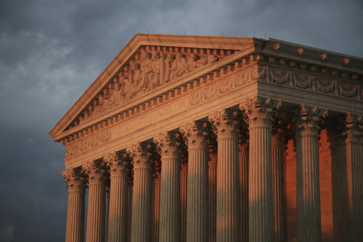The U.S. Supreme Court is seen at sunset in Washington on Oct. 4. The court issued its first ruling of the session on Tuesday.