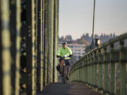 Dan Herrigstad rides his e-bike across the Interstate 5 Bridge as part of his morning commute from his east Vancouver home to the Portland Veterans Affairs Medical Center near the Oregon Health and Science University campus.