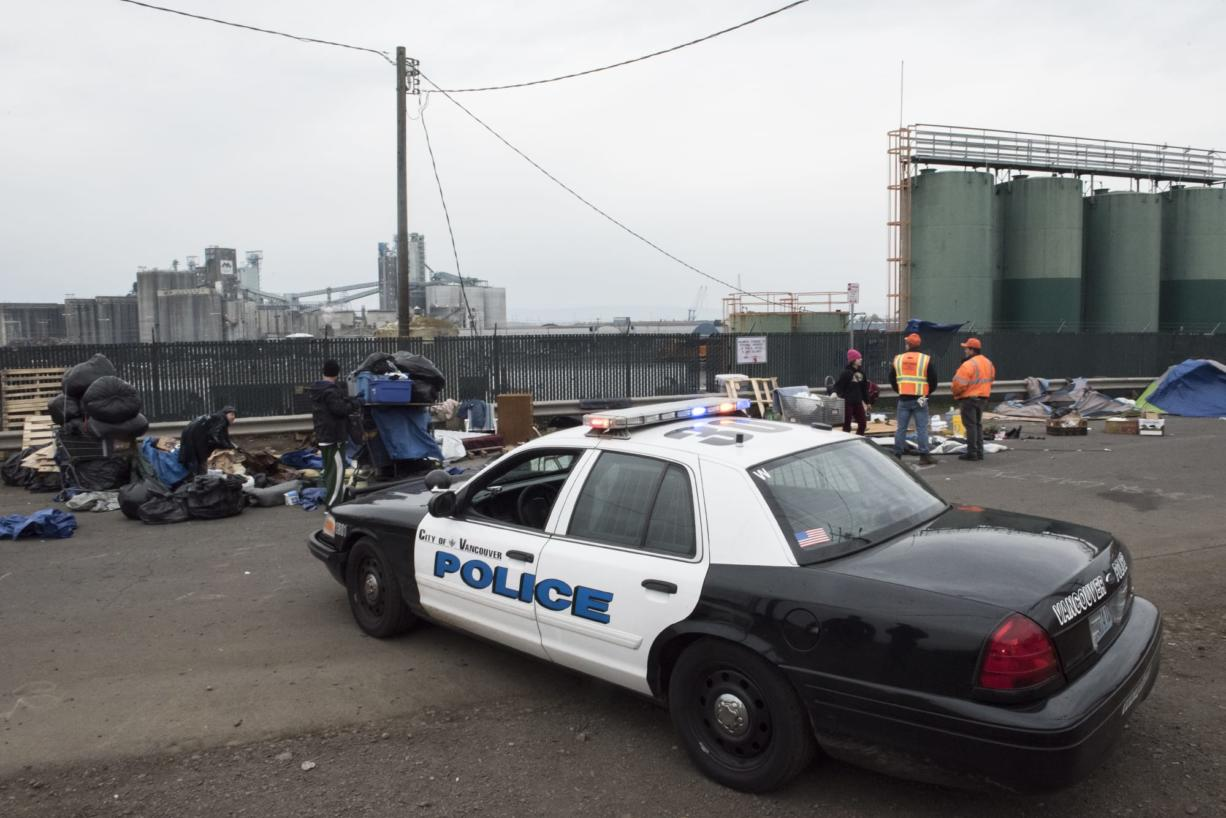 A Vancouver Police Department cruiser is parked next to a homeless encampment near the Vancouver Share House during a Nov. 21 cleanup operation.
