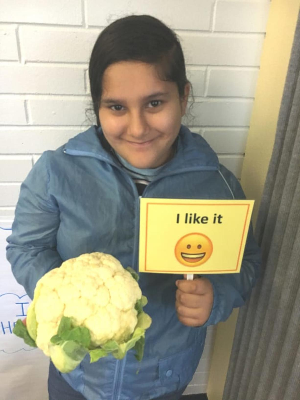 Sifton: Sifton Elementary School student Kimberly Reyes holds cauliflower, the featured ingredient of the month in Evergreen Public Schools' Harvest of the Month program.