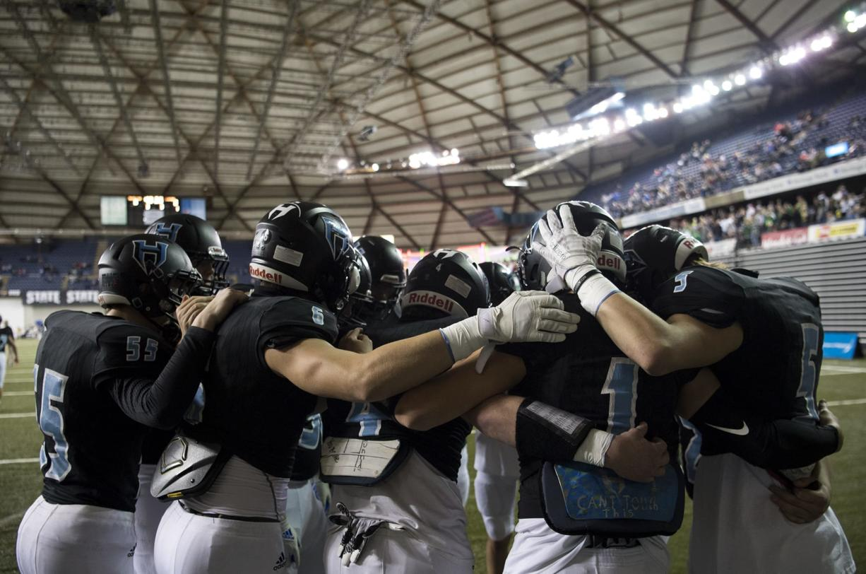 The Hawks circle up to pump each other up before the 2A state football championship game against Lynden on Saturday, Dec. 1, 2018, in Tacoma, Wash.