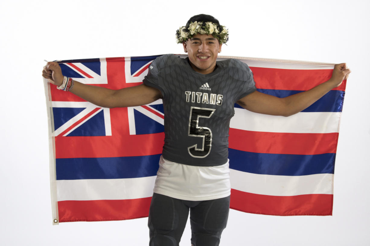 Union quarterback Lincoln Victor drapes the flag of Hawaii around his shoulders. Victor was born in Hawaii and moved to Vancouver with his familly when he was a toddler.